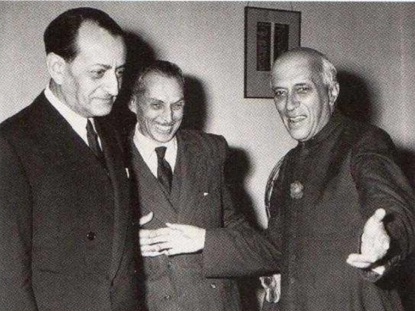 Jawaharlal Nehru with Stanislas Ostroróg, the French Ambassador to India, and André Malraux, France's first Minister of Cultural Affairs. (1958)